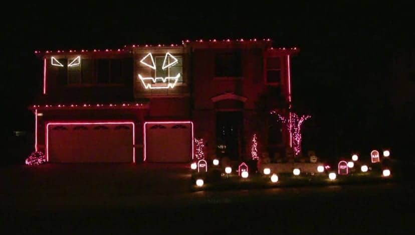 housE decorated with lights for halloween canada