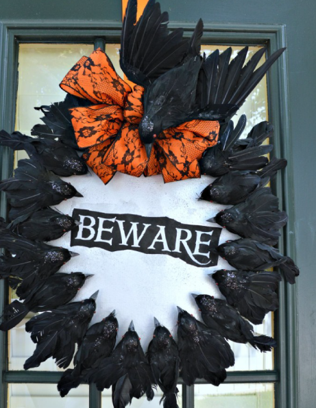 Halloween wreath with creepy crows